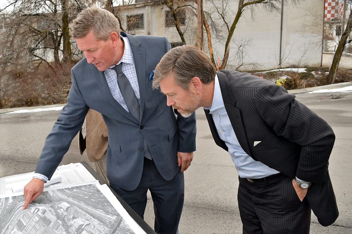 Matt Erskine, Deputy Assistant Secretary, US Department of Commerce, and Mike Caldwell, Mayor, Ogden City, look at a map.