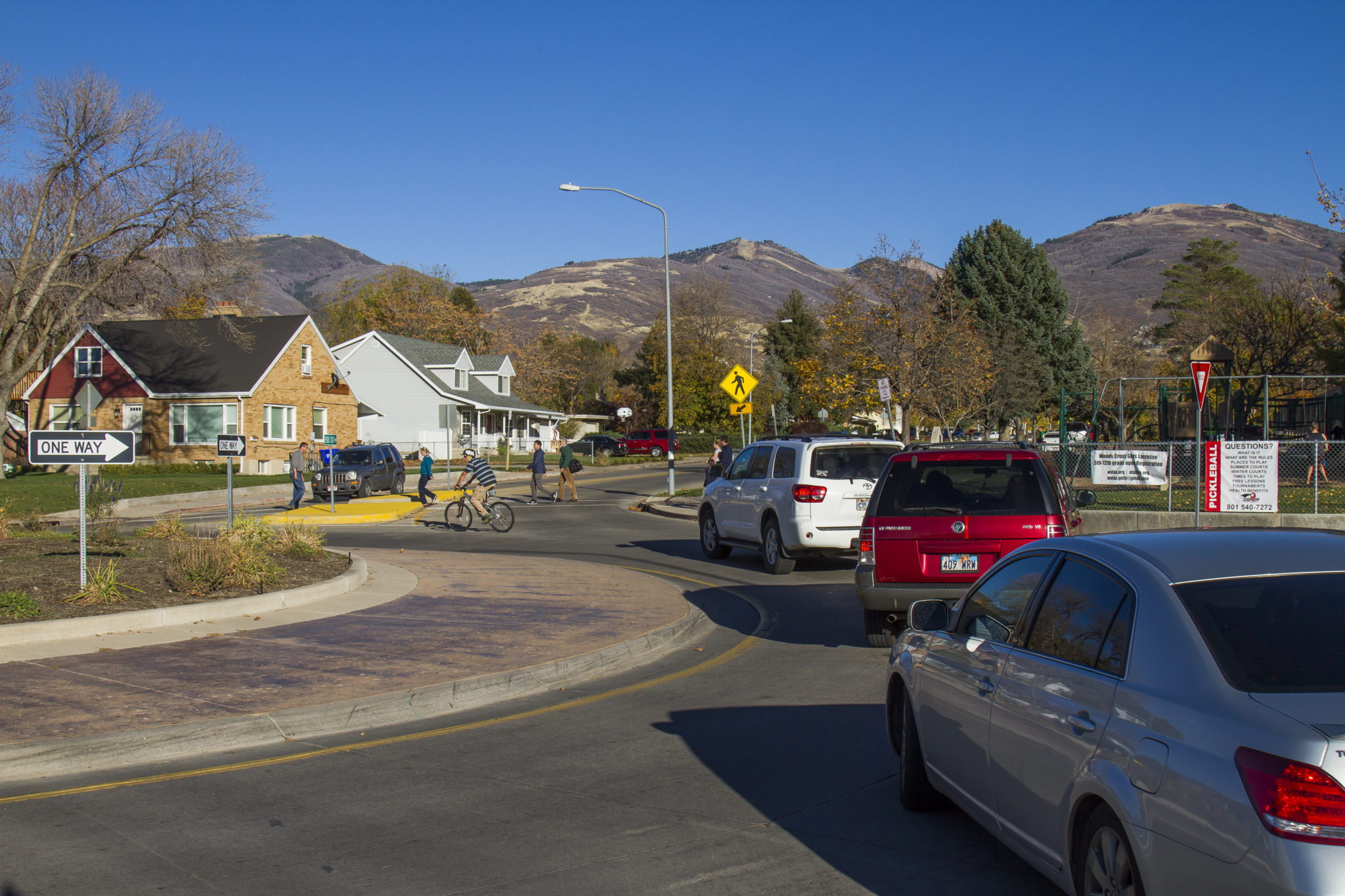 Bicyclist And Autos Utilize Rotary In Bountiful.