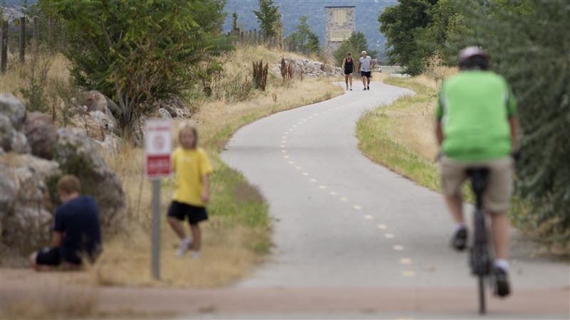 A Bicyclist And Pedestrians Use The Legacy Trail In Farmington. Photo Courtesy Of Benjamin Zack Via The Standard Examiner.