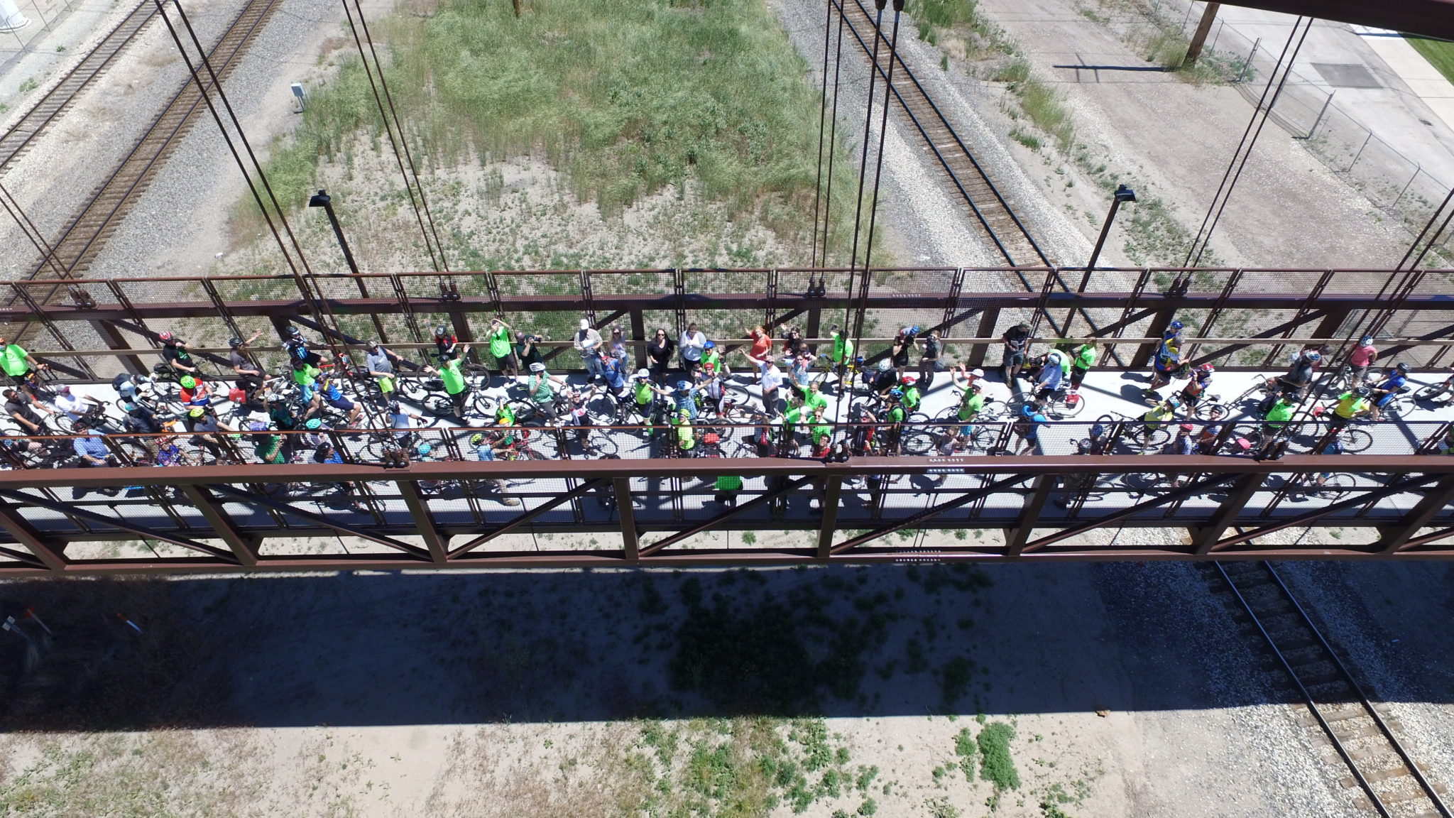Drone Image Of Bicyclists Meeting On The Jordan River Bridge During The Golden Spoke Rides And Event. Image Courtesy Of Eric Mayer.