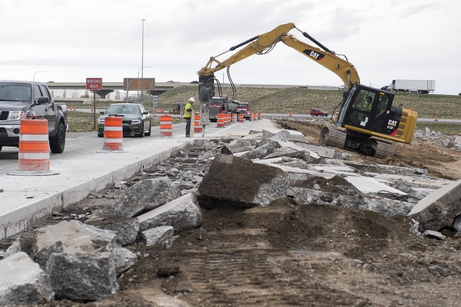 Excavator Removes Concrete At The Intersection Of I-215 And Redwood Road. Photo Courtesy Of Rick Egan Via The Salt Lake Tribune.